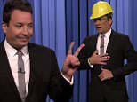 """27 October 2015 - Los Angeles - USA  **** STRICTLY NOT AVAILABLE FOR USA ***  Jimmy Fallon re-enacts his latest accident and shows off his injuries on The Tonight Show. Fallon poked fun at himself injuring his other hand over the weekend after taking a spill. 'Welcome to The Tonight Show, I'm your host Trippy Fallon,' the 41-year-old chat show host said after flashing a peace sign - after walking out on stage wearing a yellow hard hat and safety glasses. He then revealed: """"I had another mishap. This time I injured my other hand right after getting an award from Harvard. Even when I get into Harvard, I still embarrass my parents."""" He then showed off the children's plasters featuring Elmo on hnis fingers - before re-enacting how he fell over a girl who was kneeling in front of him and dropped a bottle of Jagermeister - and then fell onto the glass. He injured his other hand on Saturday after receiving a humor award from the Harvard Lampoon in Boston. Fallon needed emergency surgery four"""