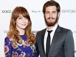 """NEW YORK, NY - JULY 17:  Actors Emma Stone and Andrew Garfield attend the """"Magic In The Moonlight"""" premiere at the Paris Theater on July 17, 2014 in New York City.  (Photo by Dimitrios Kambouris/Getty Images)"""