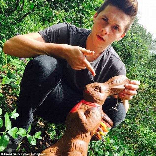 Chocolate creature: Brooklyn Beckham posed in his backyard with a sweet treat