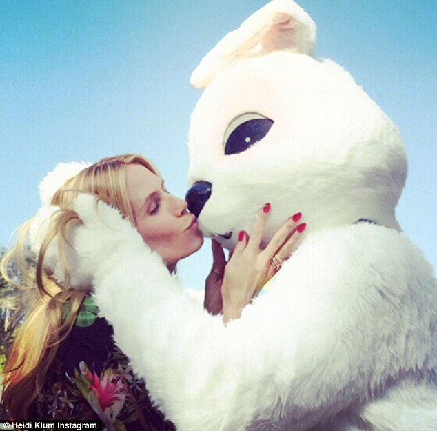 Easter kiss: Heidi Klum shared a snap of herself giving the Easter Bunny a smooch