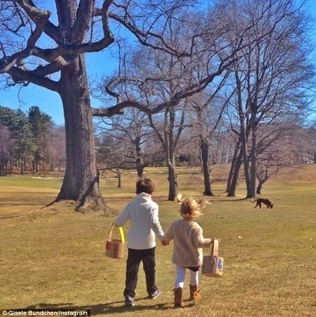 Doting parent: Gisele Bundchen watched as her son Benjamin and daughter Vivian searched for some hidden eggs