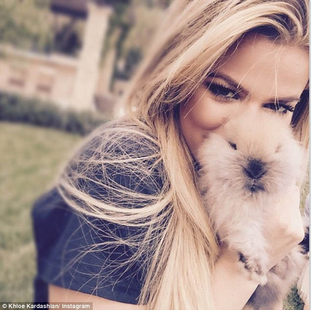 Snuggle bunny: Khloe Kardashian shared this close up shot with a furry companion after attending church with her family