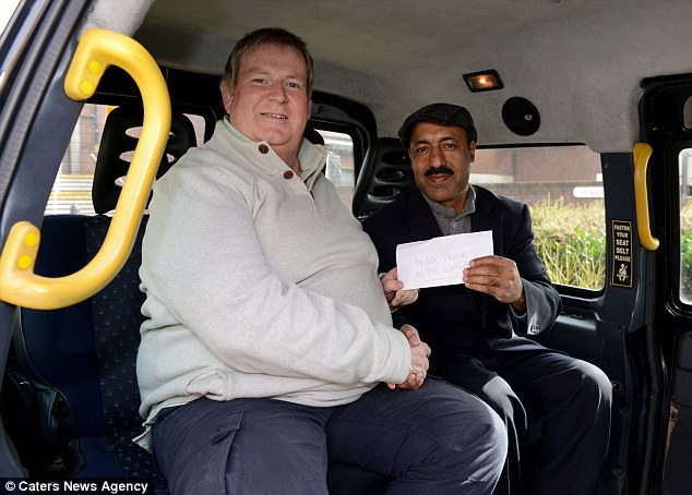 New friend: Mr Quinn hands a cash reward to Mr Nisar in an envelope labelled'to my best friend in the world'