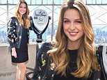 """Actress Melissa Benoist visits the Empire State Building to promote her new television series """"Supergirl"""" on Monday, Oct. 26, 2015, in New York. (Photo by Charles Sykes/Invision/AP)"""