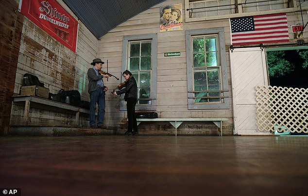 Get on down! Fiddlers perform at Twin Sisters Dance Hall in