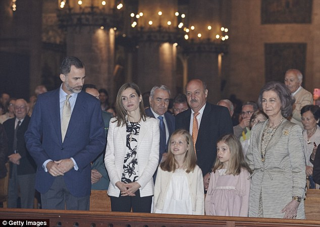 All eyes are on them: The family take their pew in the beautiful cathedral, widely considered one the island's biggest architectural masterpieces