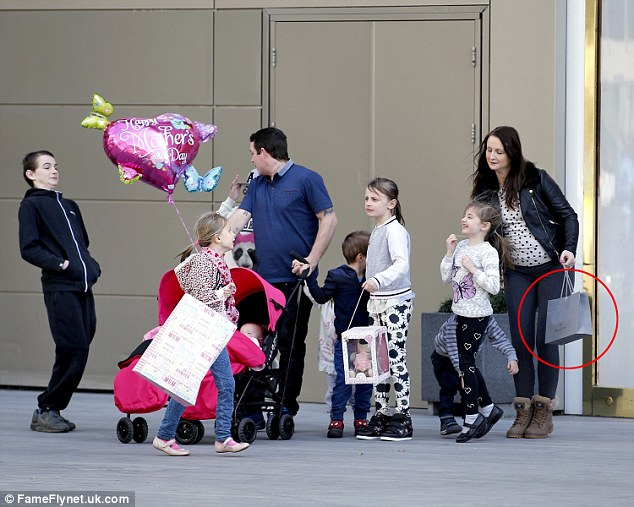 Lavish: Last month, Mr and Mrs Prudham and some of their children were spotted leaving a designer shop in London