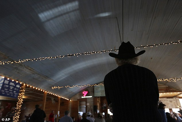 Competition: Patrons are seen listening during a fiddle festival at Twin Sisters Dance Hall