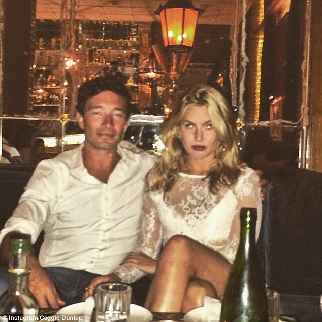 New man: Caggie Dunlop made her new relationship Instagram official by posing for a picture with Scott Sullivan during a romantic trip to Barcelona, Spain, earlier this year