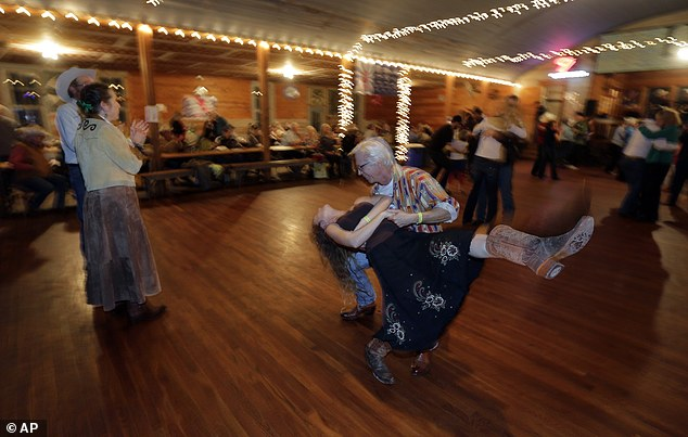 Big dipper: Visitors dance to live music by Al Dressen's Super Swing Review at Twin Sisters Dance Hall