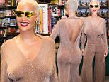 Amber Rose is seen arriving to her book signing 'How to Be a Bad Bitch' at Center City Barnes & Noble on October 27, 2015 in Philadelphia, PA. Amber Rose is seen wearing gold tone sunglasses from her own brand of sunglasses, paired with gold done earnings and tan color jumpsuit \n\nPictured: Amber Rose\nRef: SPL1162553  271015  \nPicture by: Ouzounova/Splash News\n\nSplash News and Pictures\nLos Angeles: 310-821-2666\nNew York: 212-619-2666\nLondon: 870-934-2666\nphotodesk@splashnews.com\n