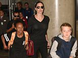 Angelina Jolie arrives at LAX airport with her kids - Maddox, Pax, Zahara and Shiloh.  Pictured: Angelina Jolie, Kids Ref: SPL1162834  271015   Picture by: MONEY$HOT / Splash News  Splash News and Pictures Los Angeles: 310-821-2666 New York: 212-619-2666 London: 870-934-2666 photodesk@splashnews.com