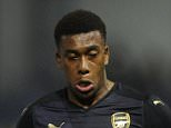 SHEFFIELD, ENGLAND - OCTOBER 27:  Alex Iwobi of Arsenal takes on Ross Wallace of Sheffield Wednesday during the Capital One Cup 4th Round match between Sheffield Wednesday and Arsenal at Hillsborough Stadium on October 27, 2015 in Sheffield, England.  (Photo by David Price/Arsenal FC via Getty Images)