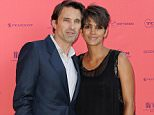 PARIS, FRANCE - JUNE 13:  (L-R) Olivier Martinez and Halle Berry attend the 'Toiles Enchantees' red carpet as part of The Champs Elysees Film Festival 2013 at Publicis Champs Elysees on June 13, 2013 in Paris, France.  (Photo by Kristy Sparow/Getty Images)