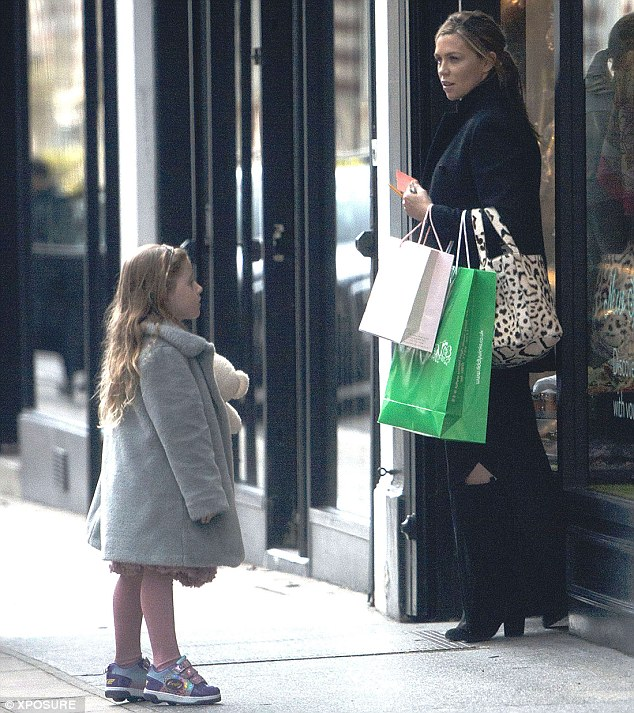Beaming:Carrying an armful of shopping bags, the lingerie model appeared to be in content spirits as she enjoyed a low-key outing with her four-year-old daughter