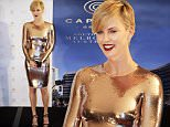 Actress Charlize Theron poses for photographers during a promotional event in Hong Kong, Wednesday, Oct. 28, 2015. (AP Photo/Vincent Yu)