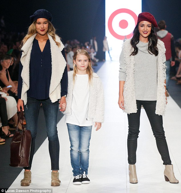 Like mother, like daughter! Mia, nine, looked slightly apprehensive as she tottered down the runway in blue jeans, a white T-shirt and fluffy bomber jacket