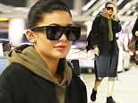 Please contact X17 before any use of these exclusive photos - x17@x17agency.com   Kylie Jenner leaves her green wig at home as she and boyfriend Tyga catch an early morning flight at LAX. October 28, 2015 X17online.com EXCLUSIVE