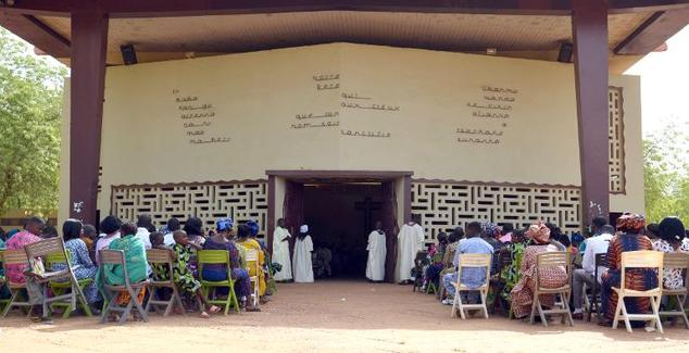 Nigerien Christians attend an Easter mass in Niamey on April 5, 2015, a few months after January's anti-christian riots killed ten people
