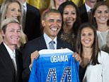 epa04998812 US President Barack Obama (C) receives a team jersey by forward Abby Wambach (L), midfielder Carli Lloyd (R) and their teammates during a ceremony to honor the US women's national soccer team in the East Room of the White House in Washington DC, USA, 27 October 2015. The US team were honored after winning the FIFA Women's World Cup 2015 final between the USA and Japan in Vancouver, Canada, on 05 July 2015.  EPA/SHAWN THEW