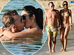EXCLUSIVE:  Duncan Bannatyne and girlfriend Nigora Whitehorn spotted on the beach while on holiday in Barbados
