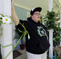 FILE - In this Aug. 25, 2015 file photo, Gavin Grimm leans on a post on his front porch during an interview at his home in Gloucester, Va.  Schools can¿t prevent transgender students from using the restrooms that correspond with their gender identities without violating federal law, the Obama administration says. The government¿s filing says a Gloucester County School Board policy that requires Grimm to use either the girls¿ restrooms or a unisex bathroom constitutes unlawful bias under Title IX, the 1972 law that prohibits sex discrimination in education. (AP Photo/Steve Helber, File)