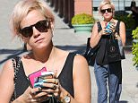 Beverly Hills, CA - English performer Lily Allen walks the streets of Beverly Hills after a quick visit to trendy spa Anastasia.\nAKM-GSI     October 29, 2015\nTo License These Photos, Please Contact :\nSteve Ginsburg\n(310) 505-8447\n(323) 423-9397\nsteve@akmgsi.com\nsales@akmgsi.com\nor\nMaria Buda\n(917) 242-1505\nmbuda@akmgsi.com\nginsburgspalyinc@gmail.com
