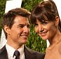 Katie Holmes and Tom Cruise (L) arrive at the Vanity Fair Oscar Party for the 84th Annual Academy Awards at the Sunset Tower on February 26, 2012 in West Hollywood, California.       AFP PHOTO / ADRIAN SANCHEZ-GONZALEZ        (Photo credit should read ADRIAN SANCHEZ-GONZALEZ/AFP/GettyImages)