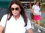 Please contact X17 before any use of these exclusive photos - x17@x17agency.com   PREMIUM EXCLUSIVE - Caitlyn Jenner wore a bright fuchsia skirt with a white top for a golf outing, then stopped by Jamba Juice for a refreshing beverage.  October 29, 2015 X17online.com
