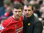 Liverpool's Alberto Moreno (left) chats with Brendan Rodgers on the touchline during the Barclays Premier League match at Anfield, Liverpool.
