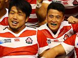 Japan celebrate victory over South Africa during the Rugby World Cup match at the Brighton Community Stadium, Brighton.