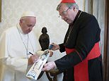epa05002426 A handout picture provided by the Vatican newspaper 'L'Osservatore Romano shows Pope Francis (L) receives a cricket bat of Canterbury cricket team from Cardinal George Pell (R), in Vatican, 29 October 2015.  EPA/L'Osservatore Romano  HANDOUT EDITORIAL USE ONLY/NO SALES/NO ARCHIVES