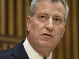 """FILE - In this Oct. 21, 2015 file photo, New York City Mayor Bill de Blasio speaks during a media briefing in New York.  De Blasio, a Democrat, announced during a Friday, Oct. 30, 2015 appearance on MSNBC's """"Morning Joe"""" that he's backing Hillary Rodham Clinton for president.  He called her the best candidate to address income inequality.(AP Photo/Seth Wenig)"""