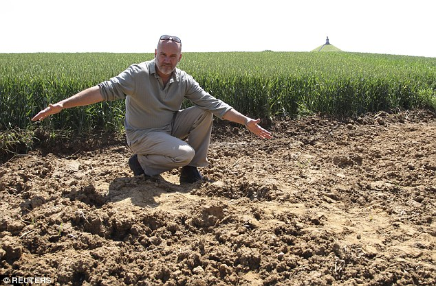 Belgian archaeologist Dominique Bosquet shows the place where he found the remains of the German soldier