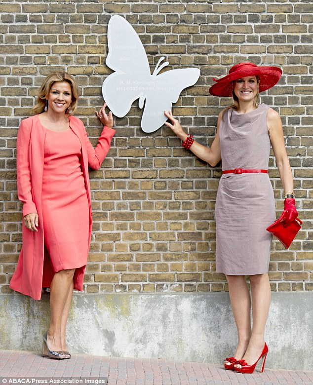 The royal (right) conducted the opening of the charity house with retired racing cyclist, Leontien van Moorsel