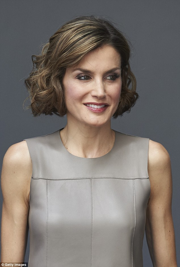 Queen Letizia, 42, stepped out in Madrid today in a taupe leather laser-cut shift dress