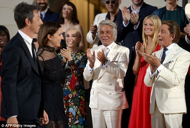 Bravo! Valentino - who retired in 2007 - jumped to his feet to give his Creative Directors Maria Grazia and Pierpaolo a standing ovation at the end of the presentation alongside Gwyneth, his partner Bruce Hoeksema, and Italian Vogue editor Franca Sozzani