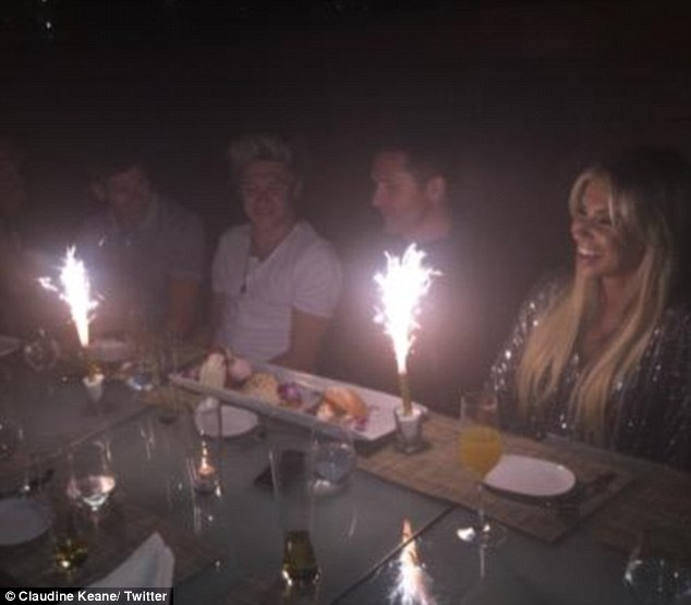 'Mortified': Claudine joked on Twitter that her poor husband was embarrassed when restaurant staff brought out a giant dessert decorated with sparklers