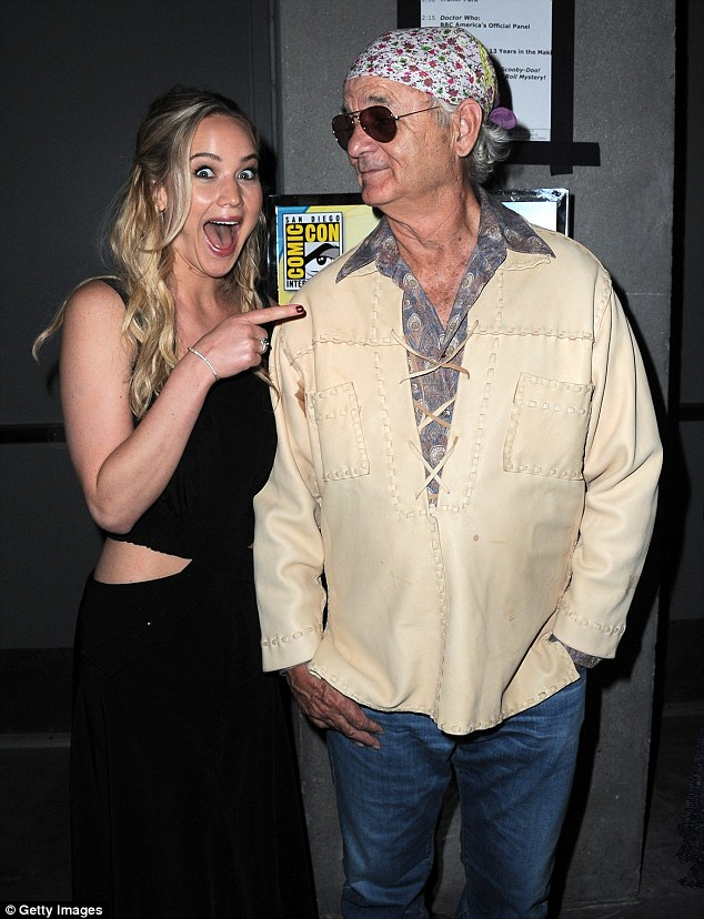 Cool as a cucumber: Bill remained relaxed as he posed beside The Hunger Games star