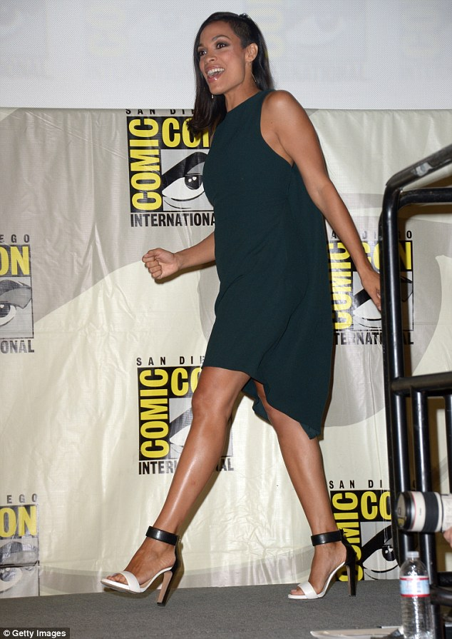 Effortless: Rosario Dawson stunned in an asymmetrical black dress as she, too, appeared at the Open Road panel
