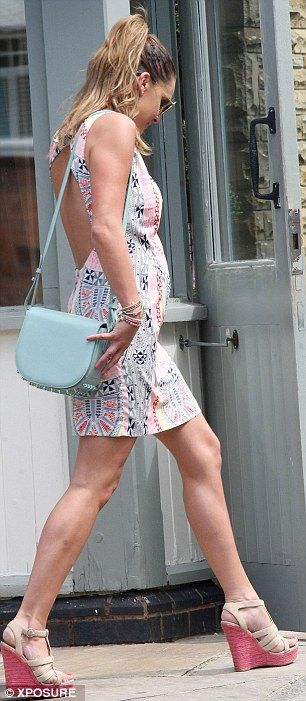 A racy touch: Danielle's dress was backless, showing some skin as the pretty mother-of-three enjoyed a relaxing day out