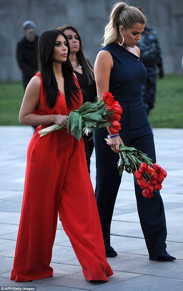 "Kim and Khloe Kardashian laid flowers at the Dzidzernagapert Armenian genocide monument's eternal flame during their April 10 visit. Marking the anniversary of the mass murder last weekend, Kim Kardashian wrote in an op-ed, 'I would like President Obama to use the word ""genocide."" It's very disappointing he hasn't used it as President'"