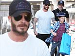 Please contact X17 before any use of these exclusive photos - x17@x17agency.com   David Beckham leaving Kitson after a mini-shopping spree with sons Brooklyn and Romeo. October 30, 2015 X17online.com EXCLUSIVE