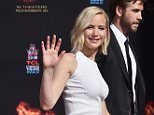 Jennifer Lawrence waves following a handprint and footprint ceremony for her, Josh Hutcherson and Liam Hemsworth outside the TCL Chinese Theatre IMAX on Saturday, Oct. 31, 2015, in Los Angeles. (Photo by Jordan Strauss/Invision/AP)