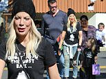144373, Tori Spelling and Dean McDermott seen picking up their kids' after the school's Halloween festival in Encino. Encino, California - Friday October 30, 2015. Photograph: Miguel Aguilar, © PacificCoastNews. Los Angeles Office: +1 310.822.0419 sales@pacificcoastnews.com FEE MUST BE AGREED PRIOR TO USAGE
