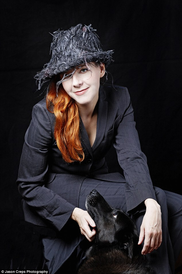 Sad loss: Singer Neko Case's dog Liza (pictured here) died in September at the age of 17