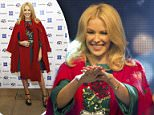 epa05006548 Australian singer Kylie Minogue switches on the Oxford Street Christmas Lights in London, Britain, 01 November 2015. Oxford Street is a main shopping street in London.  EPA/HANNAH MCKAY