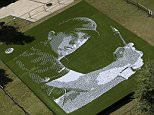 An image of Jordan Spieth is created with golf balls in downtown Dallas, Wednesday, Oct. 28, 2015. Dallas-based AT&T found a unique way to celebrate its corporate relationship with Dallas-based Jordan Spieth. It has installed a mosaic of Spieth's likeness by using 24,152 golf balls placed on tees at Main Street Gardens. (AP Photo/LM Otero)