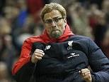 New Liverpool manager Jurgen Kloppwas captured celebrating Christian Benteke's opening goal