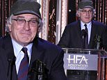 Robert De Niro accepts the Hollywood career achievement award at the Hollywood Film Awards at the Beverly Hilton Hotel on Sunday, Nov. 1, 2015, in Beverly Hills, Calif. (Photo by Jordan Strauss/Invision/AP)
